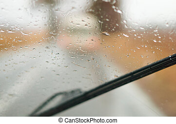 rain drops on the car glass, the road is wet from the rain