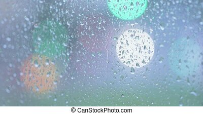 Rain drops on the glass - Flowing through the glass of large...