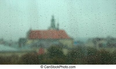 Rain Drops on the Glass of a Window, with Defocused Buildings in the Background