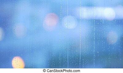 Rain drops on the window glass - blue tone