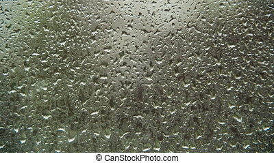 Rain Drops on the Window Glass. Time Lapse