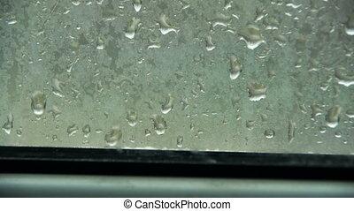 Rain Drops on the Window Glass. Time Lapse. Rain outside the...