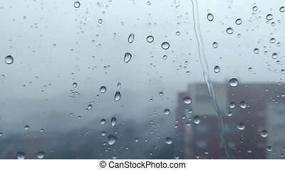 Rain drops running down on a window pane. - Storm Rain drops...