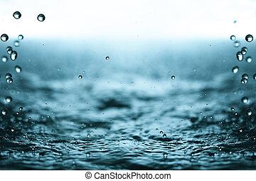 Rain drops. - Water surface and rain drops.