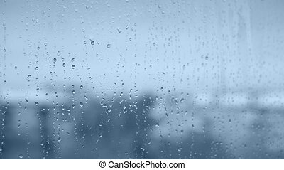 Rain drops with very soft focus in blue color.