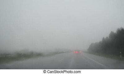 rain fall windscreen car - Driving car on highway road in...
