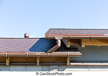 Rain gutter and roof top - Rain gutter system on a roof of...