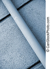 Rain gutter - Blue rain gutter on blue wall with diagonal...