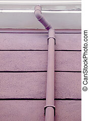 Rain gutter - Purple rain gutter on purple tiled wall