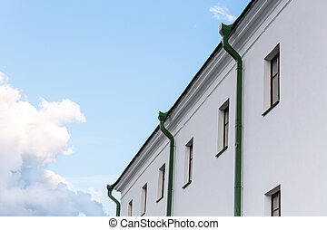 House facade with row of metal downspout