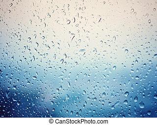 Rain in city, water drops on wet window glass