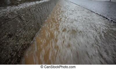 Rain in Gutter Loop - During a heavy rain, muddy water flows...