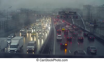Rain in Moscow. View to traffic on the bridge