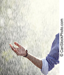 Rain in spring - Human hand under the spring or summer rain