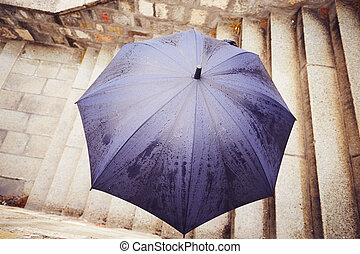 Rain in the city - Man with blue umbrella