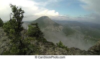 Rain in the mountains. Cave city Tepe-Kerman, Crimea,...