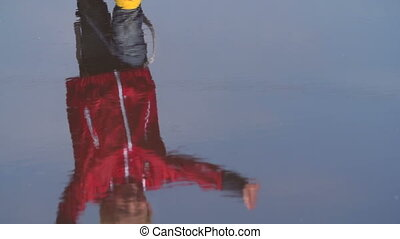 Rain is Over - Slow motion of little boy approaching camera,...