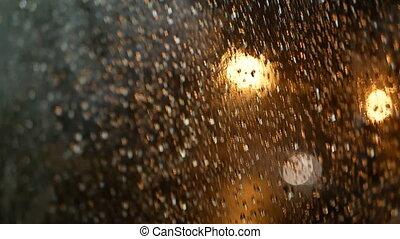 Rain night window city - Rain water drops on bus window...