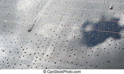 rain on back glass of car