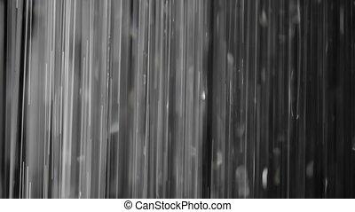 Rain on black.