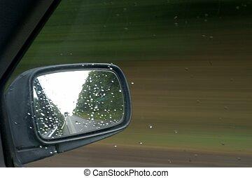 Rain on car in mirror