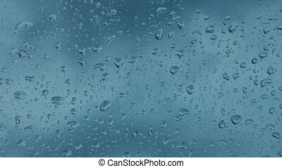 Rain On Glass With Passing Clouds Timelapse - Closeup of...
