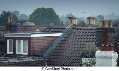 Rain On House Roofs - Typical city scene of houses in...