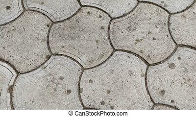 Rain on sidewalk tile. Top view