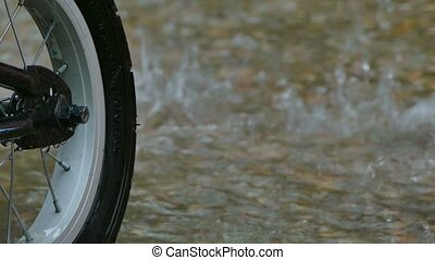 Rain on the background of a bicycle wheel