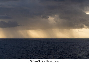 Rain over the Atlantic ocean from heavy storm clouds