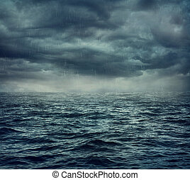 Rain over the stormy sea, abstract dark background.