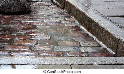Rain plattering on cobblestones
