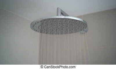 Rain Shower head closeup with falling droplets of running ...