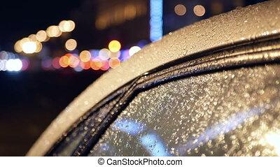 Rain street night car - Bokeh of car light on the street at...