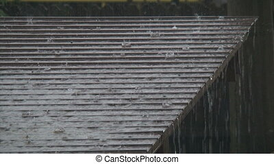 Rain water flowing from a roof