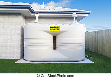 Rain water tank - Large rain water tank in suburban backyard