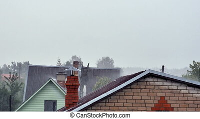 Rain with tin roof./ The old wooden structure of the roof./...