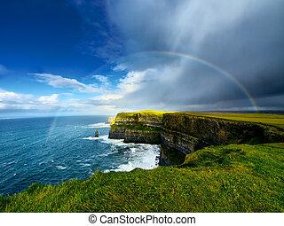 Cliffs of Moher. Ireland. - Rainbow above Cliffs of Moher. ...