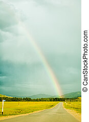 Rainbow above road in Mountain Altai. Russia - Summer ...