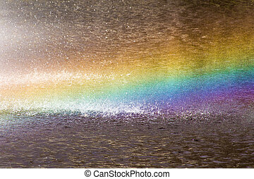 Rainbow above water surface