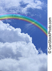 rainbow against blue sky