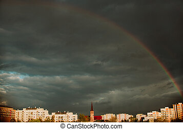 Rainbow, amazing view after rain in the city with Church