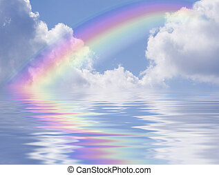 Blue sky with rainbow and clouds reflected in the water