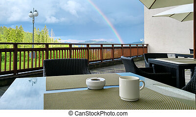 cup of coffe on table in the mountains
