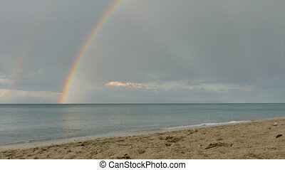 Rainbow and sea, view from beach