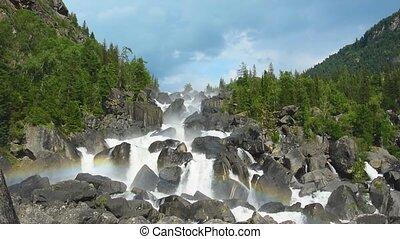 Rainbow at Uchar waterfall, Altai, Russia