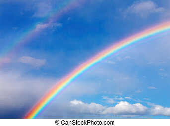 Rainbow - Blue sky with clouds and rainbow