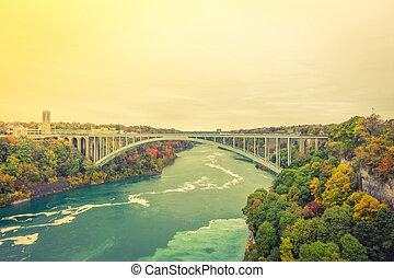 Rainbow Bridge at Niagara Falls during sunrise . ( Filtered...