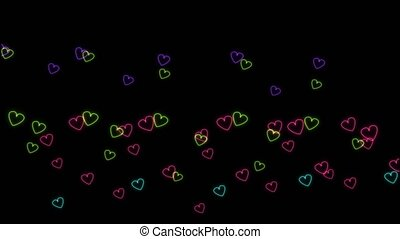 Rainbow colorful neon shape hearts slow dancing on black screen