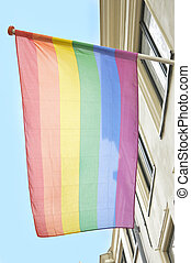 rainbow flag hanging on a building